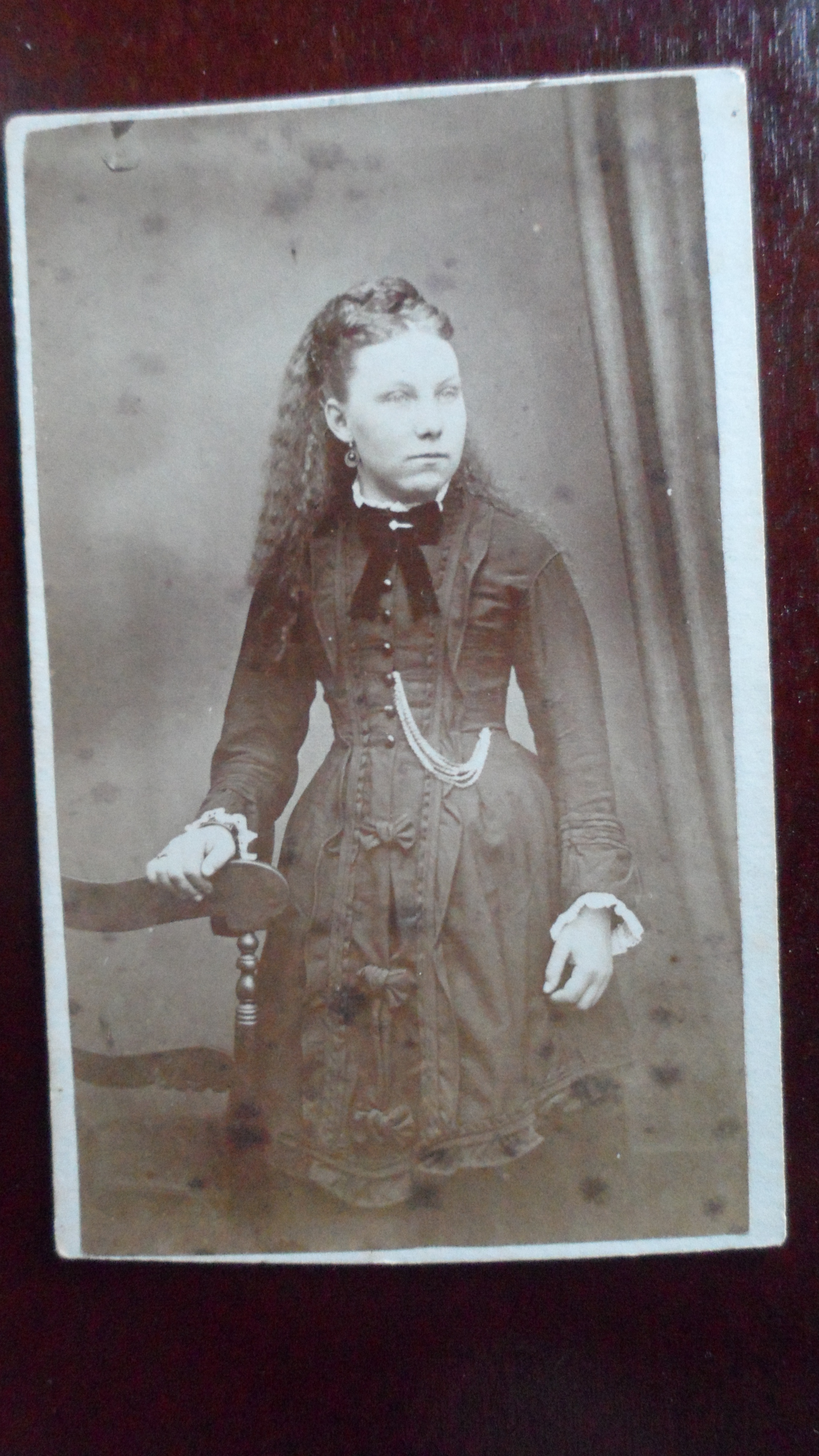 She Is Wearing Quite A Bit Of Jewlry Large Circular Earrings Bar Pin On Her Ribbon Ring And Many Chained Pocket Watch But The Real Eye Catcher