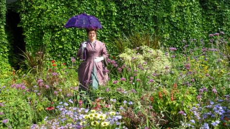 Posing in the petunias in a Purple Polonaise