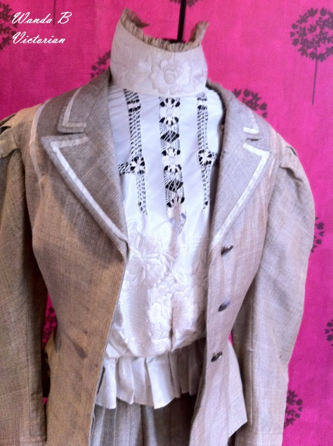 Close up of the jacket and shirtwaist.  I like the white trim.