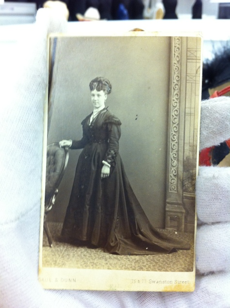 I would guess this is a 1860's-70's dress.  The photo really picked up the glossy shine of the silk.