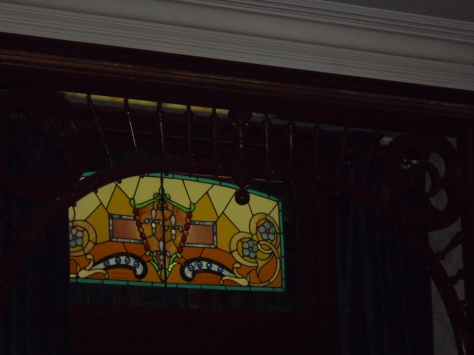 Stain glass over the parlor door.