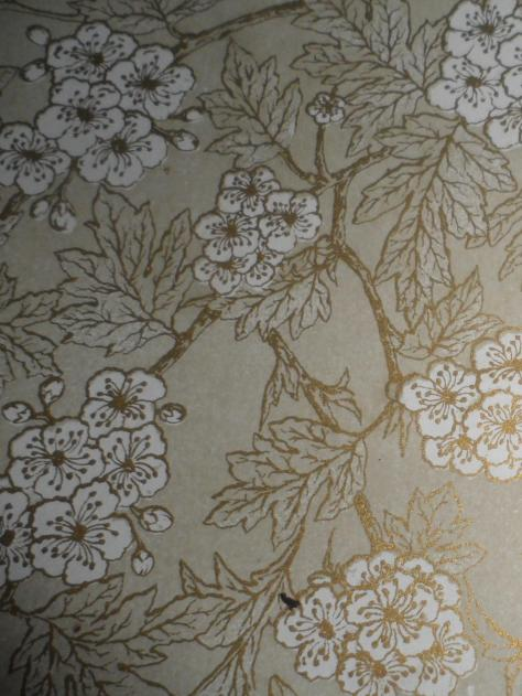 The pages have a floral motif.