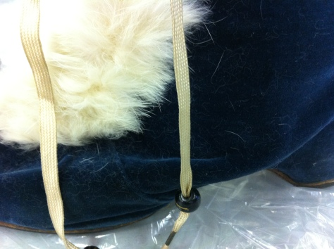 Blue velvet and white fur...my guess is rabbit.
