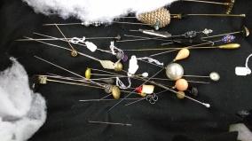 random pile of hat pins 3