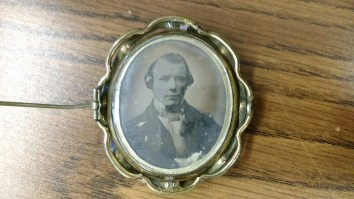 Hidden on the back and worn close to the wearer's body is this photograph. Could be memorial jewelry.